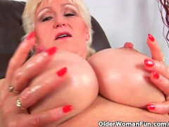 Granny with big tits finger fucks her...