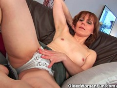 Older woman finger fucks her full bushed pussy