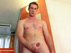 A straight guy gets wanked his huge cock by a guy in spite of him !