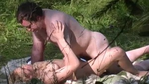 Naturist couple caught fucking in grass