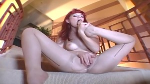 Tiny glamour babe masturbates in nude hosiery