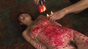 Kinky Asian slavegirl gets drenched in molten wax