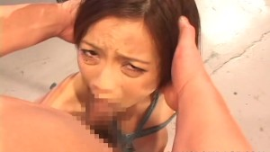Asian slag in bondage gets her tender mouth fucked