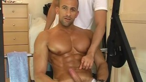 A sexy huge chest guy gets wanked his strong cock by a gay guy !