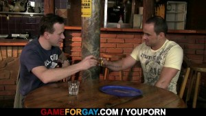 Two guys get dirty in the bar