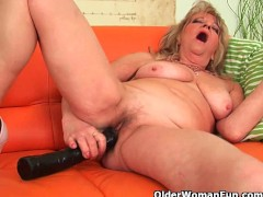 : Grandmother with large breasts pushes huge dildo inside