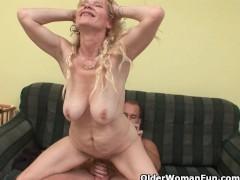 - Older mom with big tit...