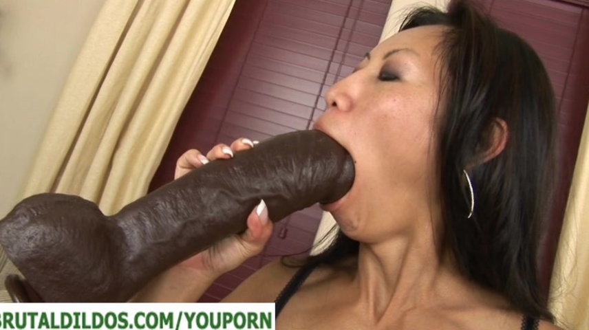 Big tit asian with a very big brutal dildo