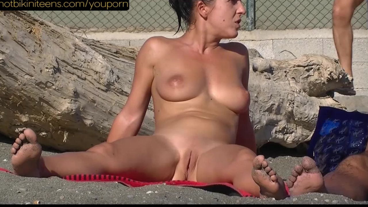Sexy Nude Milf at the beach shaved pussies