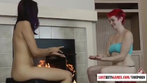 Two girls play strip paper, rock, scissors