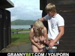 Blonde granny ride stranger's cock on public