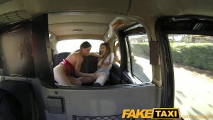 FakeTaxi Two pussy licking customers enjoy the ride