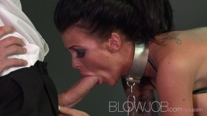 Blowjob BDSM horny tattooed sub is shackled before sucking Masters meat