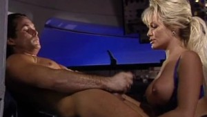 Busty babe fucked on a plane