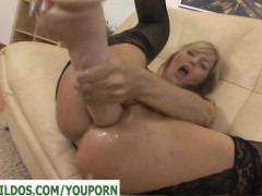A Big dildo demolishing her asshole