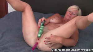 Grandma pushes a dildo up her ass and pussy