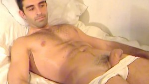 Esteban, a sexy hunk spanish guy serviced his huge cock by a guy !