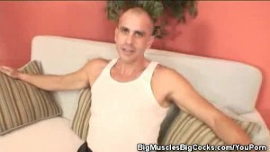 Muscled Bald Guy Masturbates