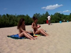 Picture Nudist beach shows off two gorgeous naked 20...