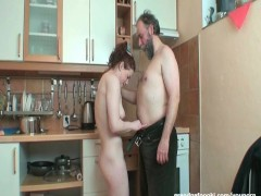 Picture Hot redhead rides cock in kitchen
