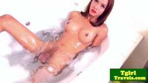 Bathing ts Bell puts a huge dildo in ass