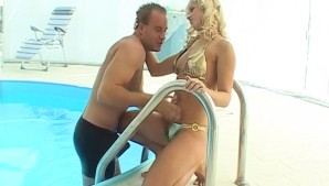 Beautiful blonde in gold bikini gets her pussy teased at the pool side