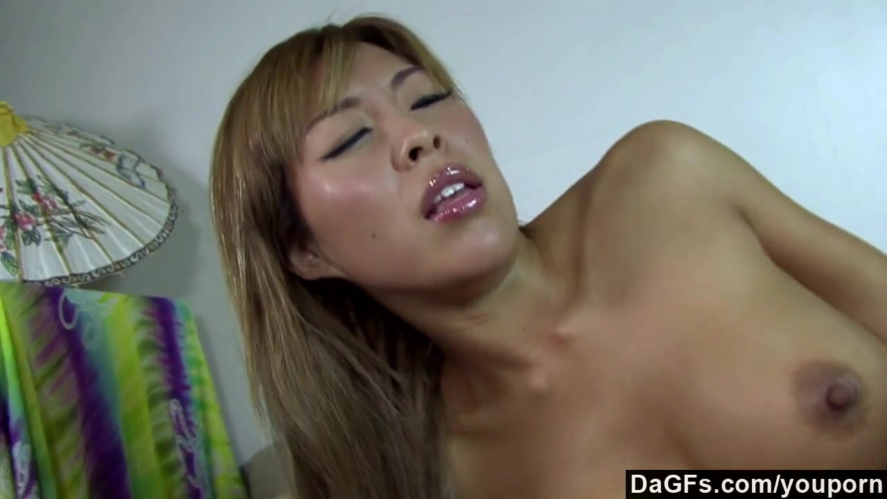 Busty asian bending over for a