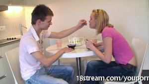 Impatient teen has sex in a kitchen