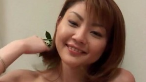 Rina Kangi with playful titties rubs and fingers her brown pussy