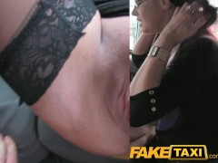 Picture FakeTaxi Secretary looking lady with huge ti...