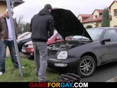 Picture Car repair man is seduced by a big guy
