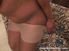 Picture Ebony granny Amanda peels off her pantyhose...