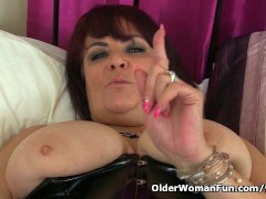 Picture UK milf Christina X finger fucks in PVC and...