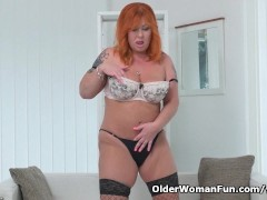 Picture Redhead milf Alex strips off and fingers her...