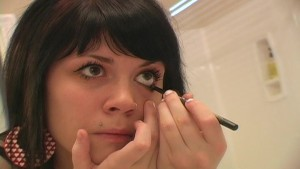 Pretty Andi applies her make up