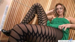 Sexy Milf In Pantyhose Strips And Masturbates