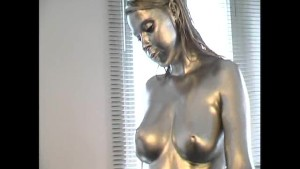 Big breast girl complete painted in silver
