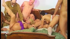 Older blonde and hot young brunette take on six cocks of all ages.