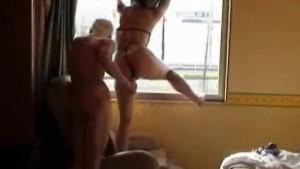 Kinky couple window fuck