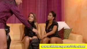 Fully clothed watersports threesome