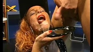 Redhead cowgirl eats cum from plate