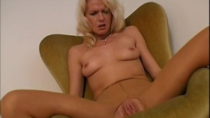 Russian MILF strips and plays