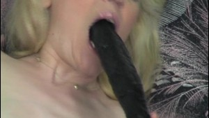 Blonde girl with multiple toys