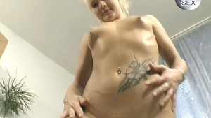 Cute young blonde playing with dildo