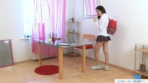 Coed asian schoolgirl undresses