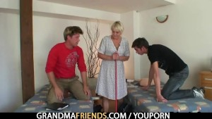 Blonde granny takes two cocks