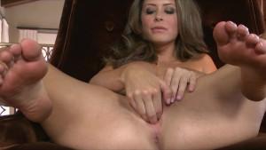 Horny big-tit brunette slut in lingerie rubs wet pussy to orgasm
