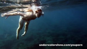 Nastya swimming nude in the sea