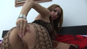 Sexy brunette put a black vibrator in her shaved vagina