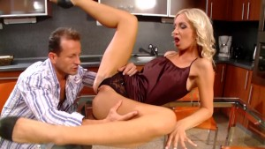 Sexy blonde takes a big cock in the kitchen